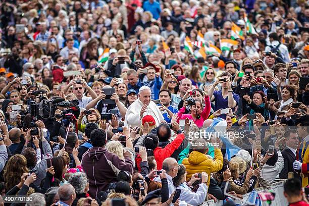 Pope Francis waves to the crowds of the faithful as he attends Weekly General Audience in St Peter's Square in Vatican City Pope Francis recalled his...