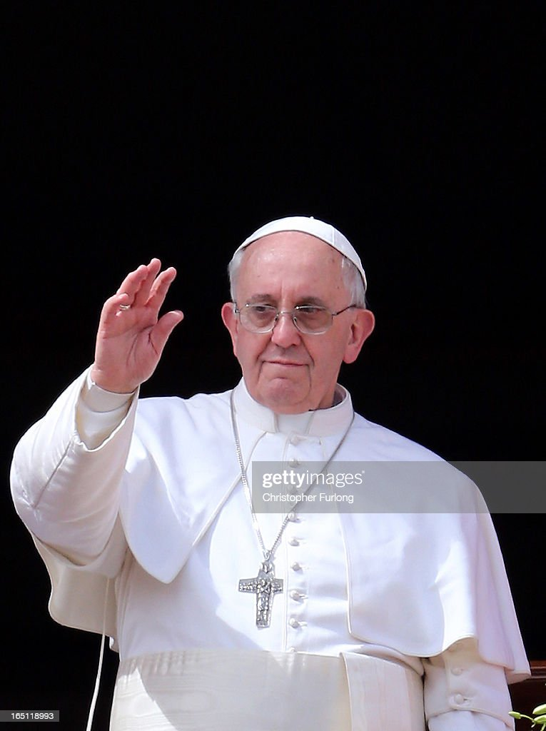<a gi-track='captionPersonalityLinkClicked' href=/galleries/search?phrase=Pope+Francis&family=editorial&specificpeople=2499404 ng-click='$event.stopPropagation()'>Pope Francis</a> waves to the faithful after giving his first 'Urbi et Orbi' blessing from the balcony of St. Peter's Basilica during Easter Mass on March 31, 2013 in Vatican City, Vatican. <a gi-track='captionPersonalityLinkClicked' href=/galleries/search?phrase=Pope+Francis&family=editorial&specificpeople=2499404 ng-click='$event.stopPropagation()'>Pope Francis</a> delivered his message to the gathered faithful from the central balcony of St. Peter's Basilica in St. Peter's Square after his first Holy week as Pontiff.