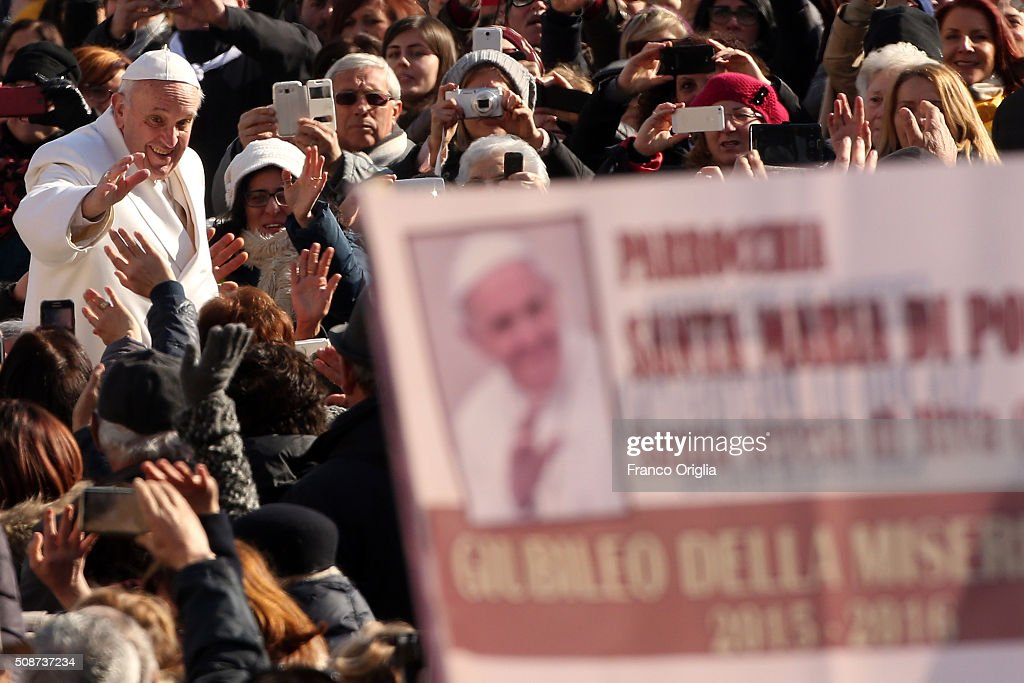 Pope Francis waves to the faithful as he arrives at St. Peter's Square for a meeting with members of 'Padre Pio' Prayer Groups on February 6, 2016 in Vatican City, Vatican. Pope Francis today greeted members of 'Padre Pio' Prayer Groups, who are in Rome to venerate the relics of the great saint, which have been translated to St. Peter's Basilica and are there exposed for veneration by the faithful in connection with the ongoing Extraordinary Jubilee Year of Mercy.