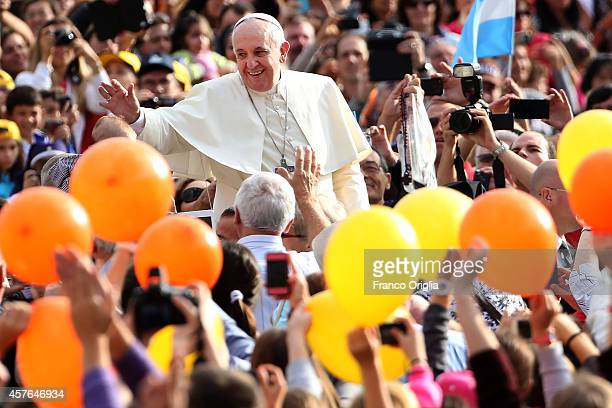 Pope Francis waves to the faithful as he arrives in St Peter's Square for his weekly audience on October 22 2014 in Vatican City Vatican Speaking to...