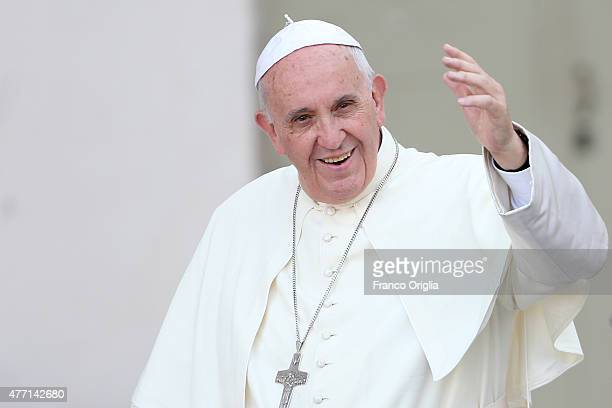 Pope Francis waves to the faithful as he arrives in St Peter's Square for a meeting with the Roman Diocesans on June 14 2015 in Vatican City Vatican...