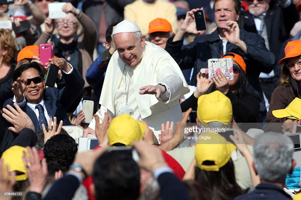 Pope Francis waves to the faithful as he arrives in St. Peter's Square for a Jubilee Audience on April 30, 2016 in Vatican City, Vatican. Pope Francis held an extraordinary Jubilee Audience in St. Peter's Square for thousands of eager pilgrims. The Audience also celebrated the Jubilee for members of the police and armed forces.
