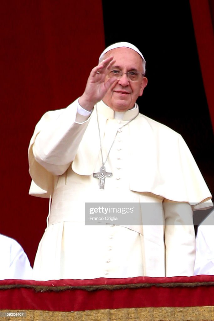 <a gi-track='captionPersonalityLinkClicked' href=/galleries/search?phrase=Pope+Francis&family=editorial&specificpeople=2499404 ng-click='$event.stopPropagation()'>Pope Francis</a> waves to the faithful as he delivers his Christmas Day message from the central balcony of St Peter's Basilica on December 25, 2013 in Vatican City, Vatican. The 'Urbi et Orbi' blessing (to the city and to the world) is recognised as a Christmas tradition by Catholics with the <a gi-track='captionPersonalityLinkClicked' href=/galleries/search?phrase=Pope+Francis&family=editorial&specificpeople=2499404 ng-click='$event.stopPropagation()'>Pope Francis</a> focusing this year on the peace in the world.