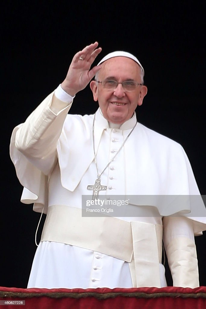 <a gi-track='captionPersonalityLinkClicked' href=/galleries/search?phrase=Pope+Francis&family=editorial&specificpeople=2499404 ng-click='$event.stopPropagation()'>Pope Francis</a> waves to the faithful as he delivers his Christmas Day message from the central balcony of St Peter's Basilica on December 25, 2014 in Vatican City, Vatican. The 'Urbi et Orbi' blessing (to the city and to the world) is recognised as a Christmas tradition by Catholics with the <a gi-track='captionPersonalityLinkClicked' href=/galleries/search?phrase=Pope+Francis&family=editorial&specificpeople=2499404 ng-click='$event.stopPropagation()'>Pope Francis</a> focusing this year on the peace in the world.
