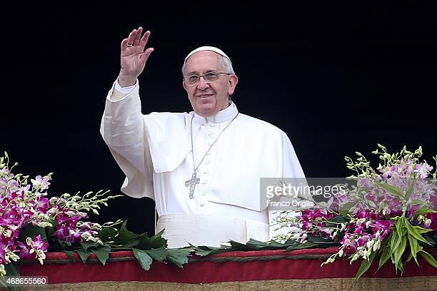 Pope Francis waves to the faithful as he delivers his 'Urbi et Orbi' blessing message from the central balcony of St Peter's Basilica at the end of...