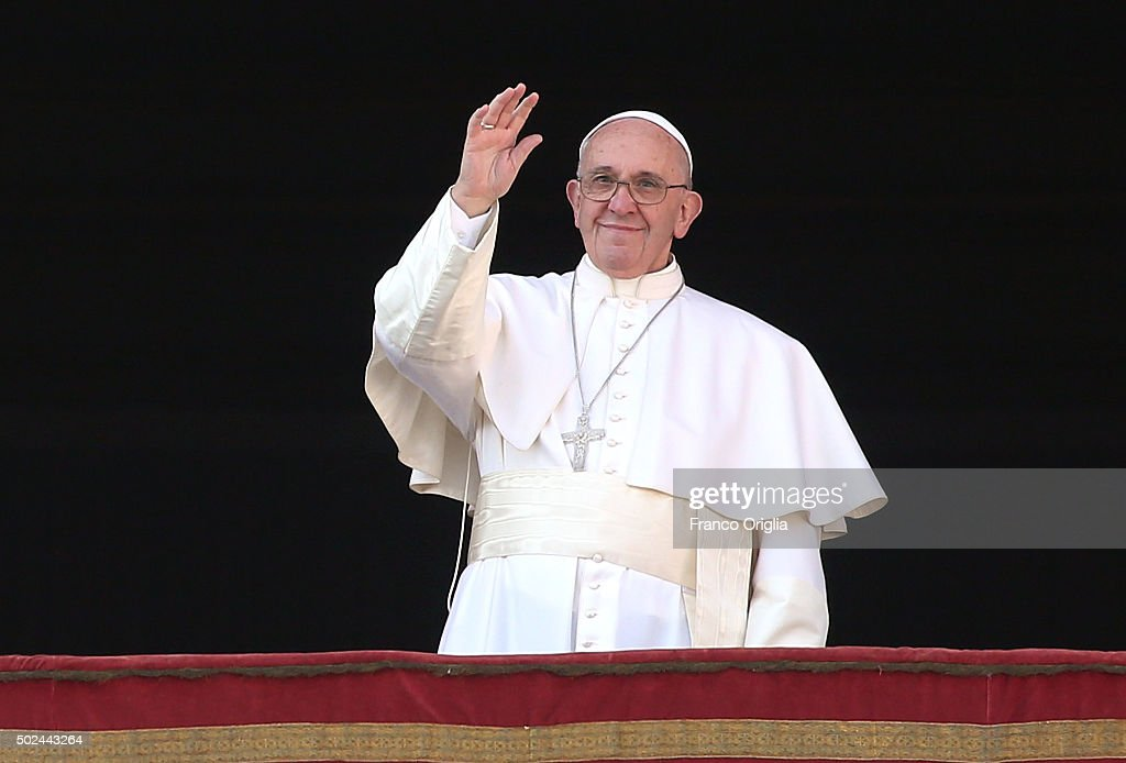 Pope Francis waves to the faithful as he delivers his 'Urbi et Orbi' blessing message from the central balcony of St Peter's Basilica on December 25, 2015 in Vatican City, Vatican. During his Christmas message Pontiff Sayd ' My thoughts turn to those affected by brutal acts of terrorism, particularly the recent massacres which took place in Egyptian airspace, in Beirut, Paris, Bamako and Tunis.