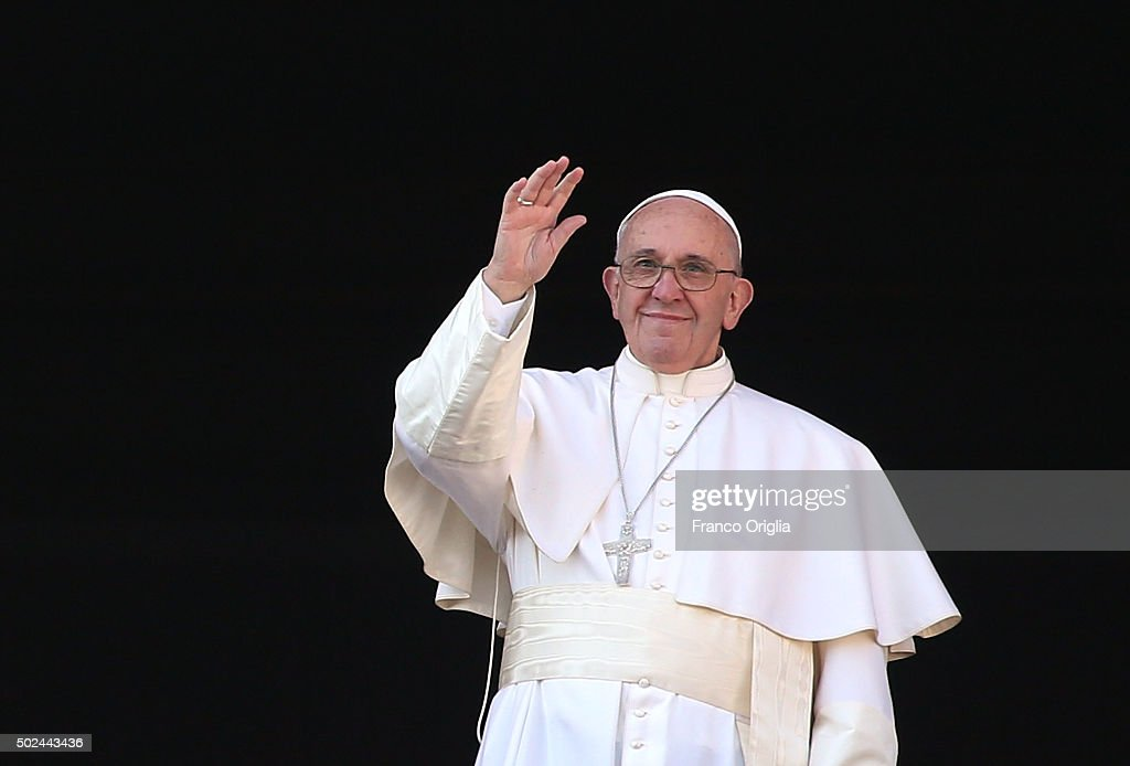 <a gi-track='captionPersonalityLinkClicked' href=/galleries/search?phrase=Pope+Francis&family=editorial&specificpeople=2499404 ng-click='$event.stopPropagation()'>Pope Francis</a> waves to the faithful as he delivers his 'Urbi et Orbi' blessing message from the central balcony of St Peter's Basilica on December 25, 2015 in Vatican City, Vatican. During his Christmas message Pontiff Sayd ' My thoughts turn to those affected by brutal acts of terrorism, particularly the recent massacres which took place in Egyptian airspace, in Beirut, Paris, Bamako and Tunis.