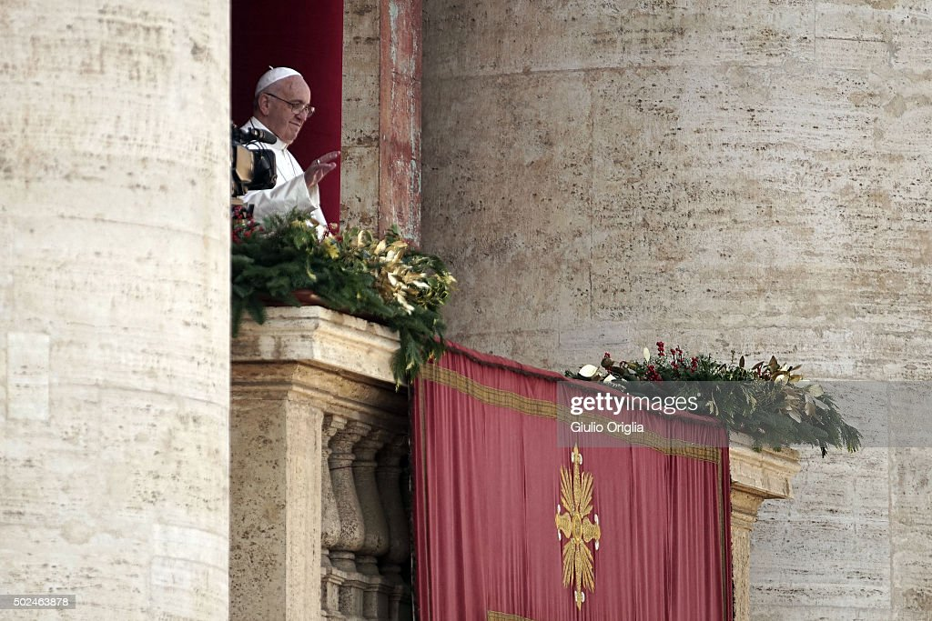 Pope Francis waves to the faithful as he delivers his 'Urbi et Orbi' blessing message from the central balcony of St Peter's Basilica on December 25, 2015 in Vatican City, Vatican. During his Christmas message the Pontiff said, 'My thoughts turn to those affected by brutal acts of terrorism, particularly the recent massacres which took place in Egyptian airspace, in Beirut, Paris, Bamako and Tunis.'