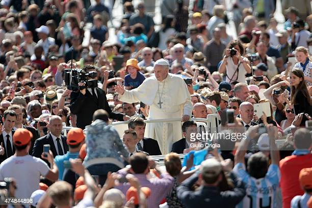 Pope Francis waves to the faithful as he holds his weekly audience in St Peter's Square on May 27 2015 in Vatican City Vatican During his speech the...