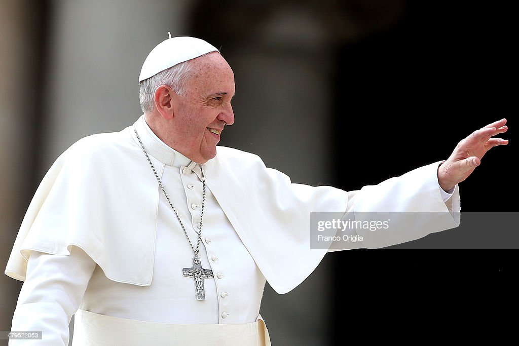 Pope Francis waves to the faithful as he holds his weekly audience in St. Peter's Square on March 19, 2014 in Vatican City, Vatican. Pope Francis celebrated the Feast of St. Joseph by saying the saint is a model for all fathers and educators.
