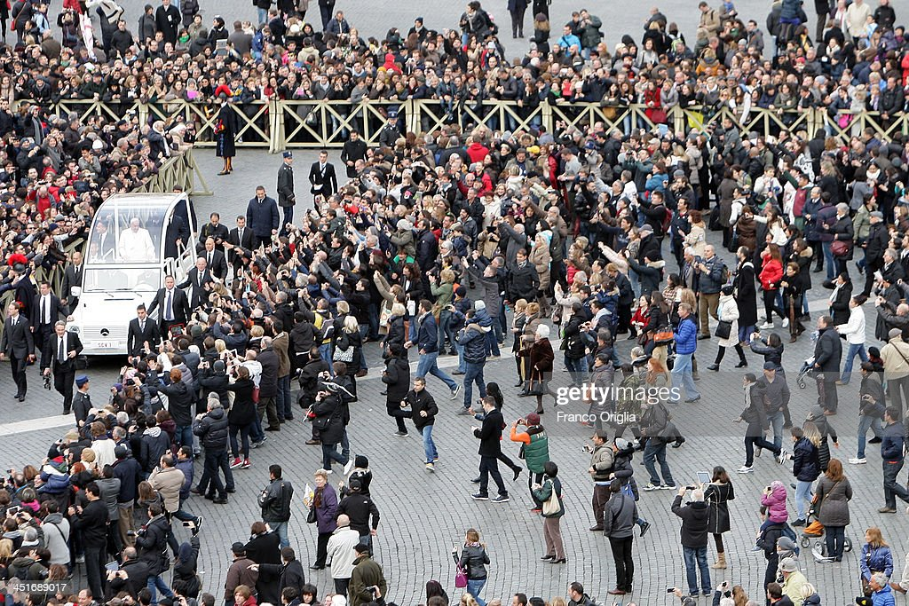<a gi-track='captionPersonalityLinkClicked' href=/galleries/search?phrase=Pope+Francis&family=editorial&specificpeople=2499404 ng-click='$event.stopPropagation()'>Pope Francis</a> waves to the faithful as he leaves on popemobile during the end of the Solemnity of Christ the King in St. Peter's square on November 24, 2013 in Vatican City, Vatican. Today's solemnity of Our Lord Jesus Christ, King of the Universe, the crowning of the liturgical year, marks the conclusion of the Year of Faith proclaimed earlier by Pope emeritus Benedict XVI in the last year of his reign.