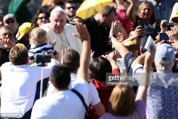 Pope Francis waves to the faithful as he leaves St Peter's Square at the end of a canonisation ceremony on October 15 2017 in Vatican City Vatican...