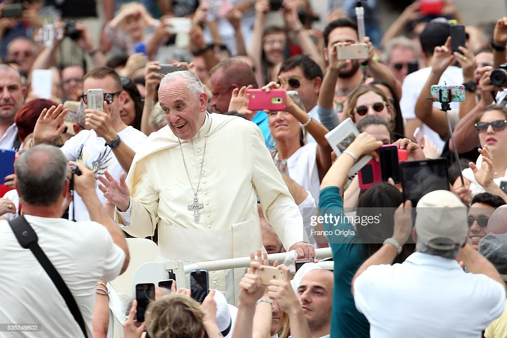 Pope Francis waves to the faithful at the end of a Mass for Jubilee of Deacons in St. Peter's Square on May 29, 2016 in Vatican City, Vatican. The Church marked the Extraordinary Jubilee Year of Mercy in a special way with the Jubilee of Deacons. As their very title suggests taken as it is from the Greek word for 'servant', diakonos Deacons are ordained to a ministry of service in the Church.
