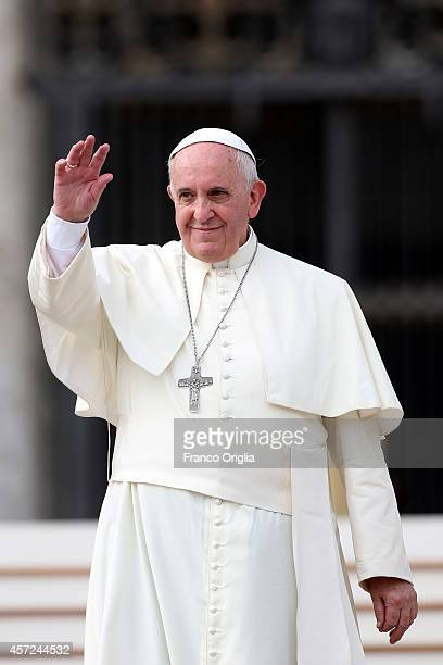 Pope Francis waves to the faithful during his weekly audience in St Peter's Square on October 15 2014 in Vatican City Vatican Speaking to the crowds...