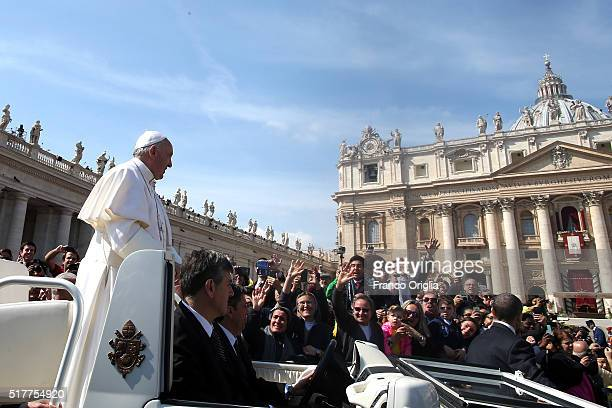 Pope Francis waves to the faithful gathered in St Peter's Square at the end of the Easter Mass on March 27 2016 in Vatican City Vatican Following the...