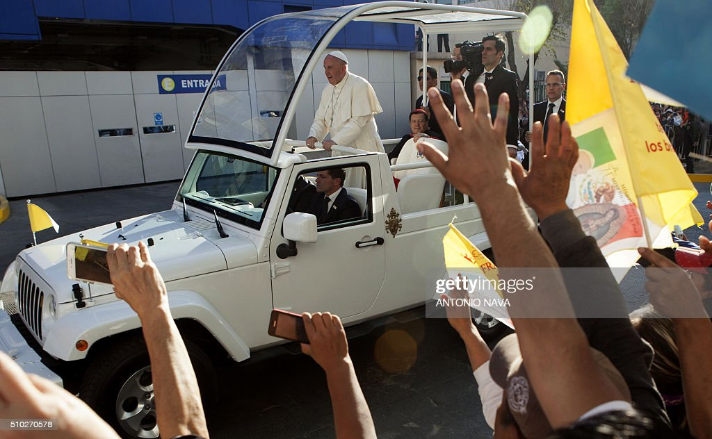 Pope Francis waves to the faithful upon his arrival to the Federico Gomez Children's Hospital in Mexico City on February 14, 2016. The pope has chosen to visit some of Mexico's most troubled regions during his five-day trip to the world's second most populous Catholic country. AFP PHOTO/ANTONIO NAVA / AFP / ANTONIO NAVA