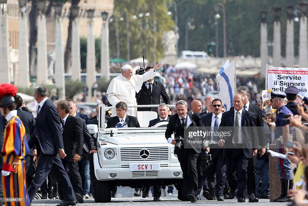 <a gi-track='captionPersonalityLinkClicked' href=/galleries/search?phrase=Pope+Francis&family=editorial&specificpeople=2499404 ng-click='$event.stopPropagation()'>Pope Francis</a> waves to the pilgrims gathered in Saint Peter's Square at the end of a mass on the occasion of the Marian Day on October 13, 2013 in Vatican City, Vatican. <a gi-track='captionPersonalityLinkClicked' href=/galleries/search?phrase=Pope+Francis&family=editorial&specificpeople=2499404 ng-click='$event.stopPropagation()'>Pope Francis</a> consecrated the world to the Immaculate Heart of Mary as part of Marian Day celebrations that will involve the statue of Our Lady of Fatima. The statue is normally kept in the Shrine of Fatima in Portugal but is in Rome this weekend for the consecration which is one of the highlights of the ongoing Year of Faith.