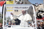Pope Francis waves to worshipers upon his arrival in the Manger Square on May 25 2014 Pope Francis addressed the IsraeliPalestinian conflict as...
