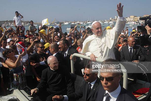 Pope Francis waves upon arrival during his visit to the island of Lampedusa a key destination of tens of thousands of wouldbe immigrants from Africa...