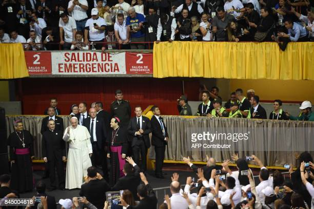 Pope Francis waves upon arrival for a meeting with religious people at La Macarena convention centre a former bullring in Medellin Colombia on...