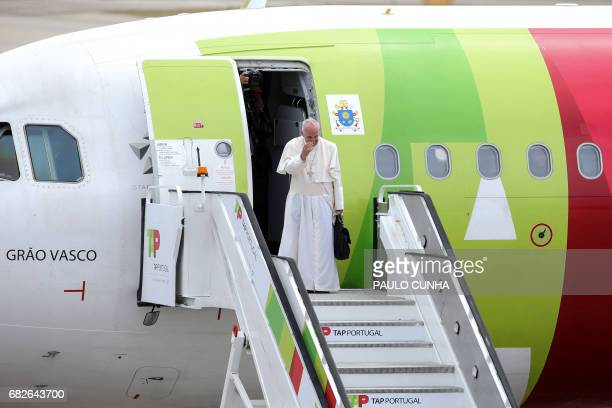 Pope Francis waves upon his departure from Portugal before boarding an airplane on its way to Rome at Monte Real air base in Leiria on May 13 2017...
