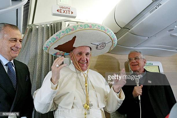 Pope Francis wears a traditional Mexican sombrero hat received as a gift by a Mexican journalist on February 12 aboard the plane to Havana Pope...