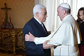 Pope Francis welcomes Palestinian authority President Mahmud Abbas during a private audience on May 16 2015 in Vatican AFP PHOTO POOL / ALBERTO...