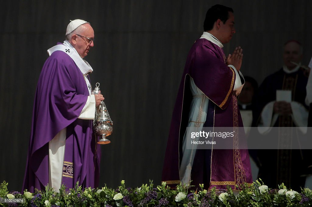 Pope Francis wlaks with a censer during a mass for the people at Ecatepec on February 14, 2016 in Ecatepec, Mexico. Pope Francis is on a five days visit in Mexico from February 12 to 17 where he is expected to visit five states.