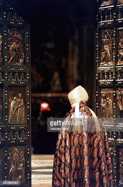 Pope John Paul enters the Holy Door of St Peter's Basilica at the end of the Christmas Night mass ceremony to mark the start of the Roman Catholic...