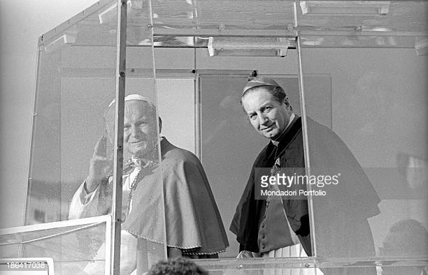 Pope John Paul II and Italian cardinal Carlo Maria Martini on the popemobile greeting the crowd rushed up to attend the mass officiated in the...
