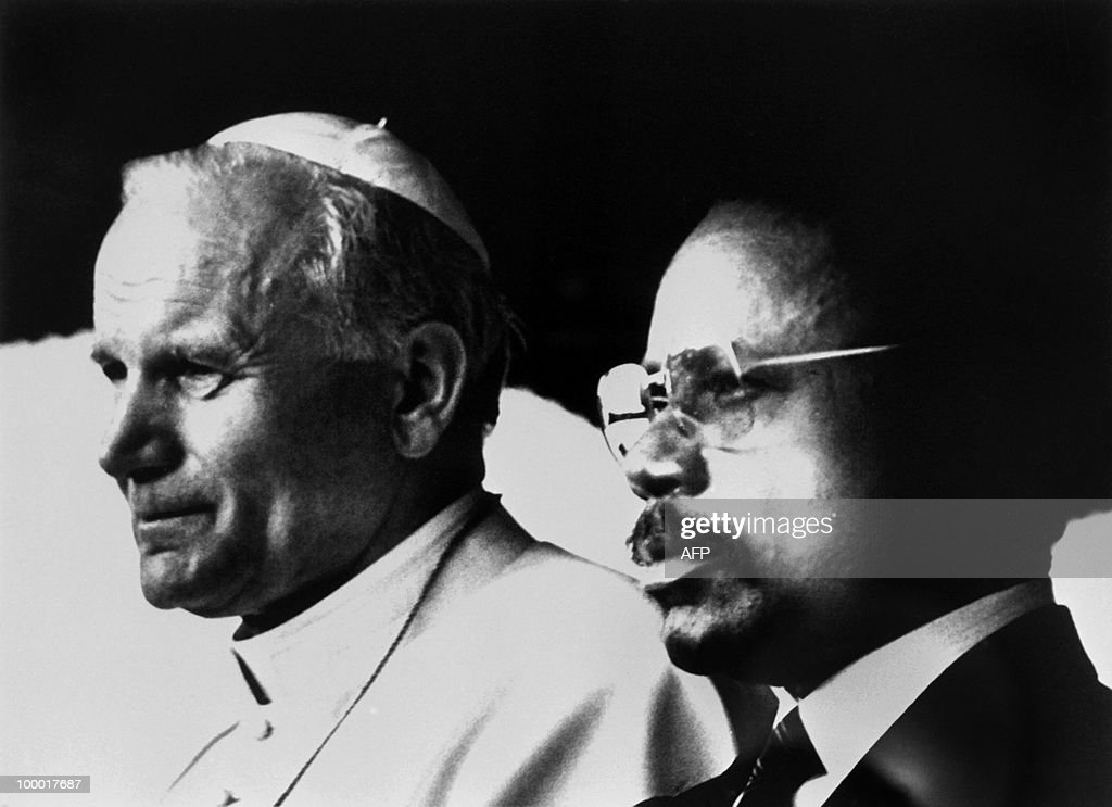 Pope John Paul II and Omar Bongo, president of Gabon, listen to national anthems on February 17, 1982, in Libreville, upon pope's arrival to official visit to Gabon. AFP PHOTO Luciano Mellace