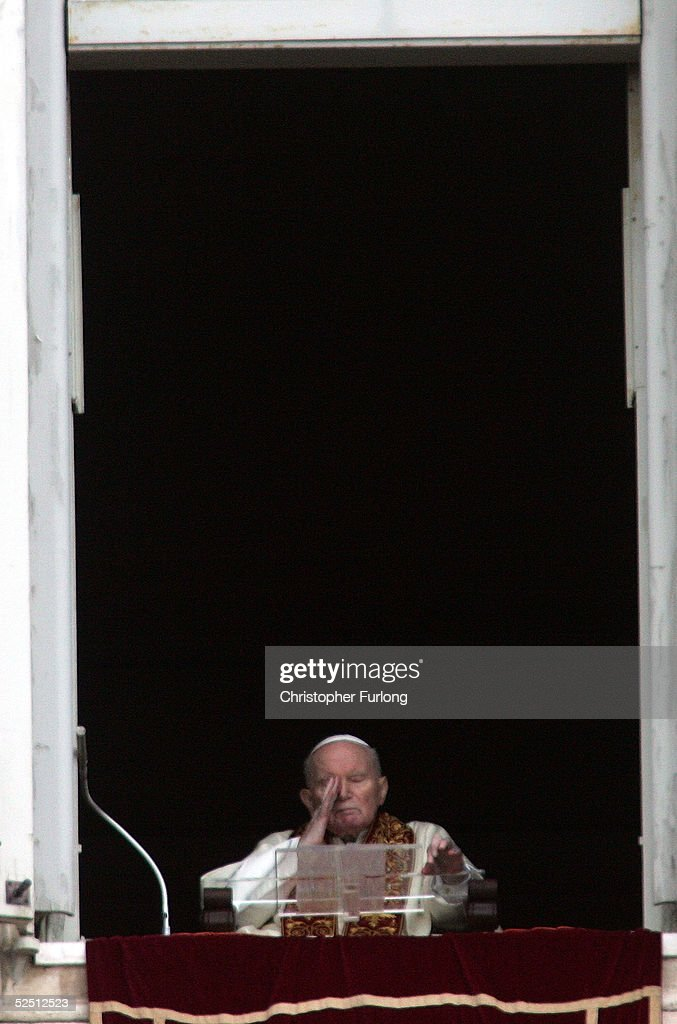 Pope John Paul II appears at the window of his private apartments on March, 27, 2005 Vatican City. Anguished and unable to speak he blessed the thousands of Pilgrims in St Peter's Square at the end of Easter Mass.