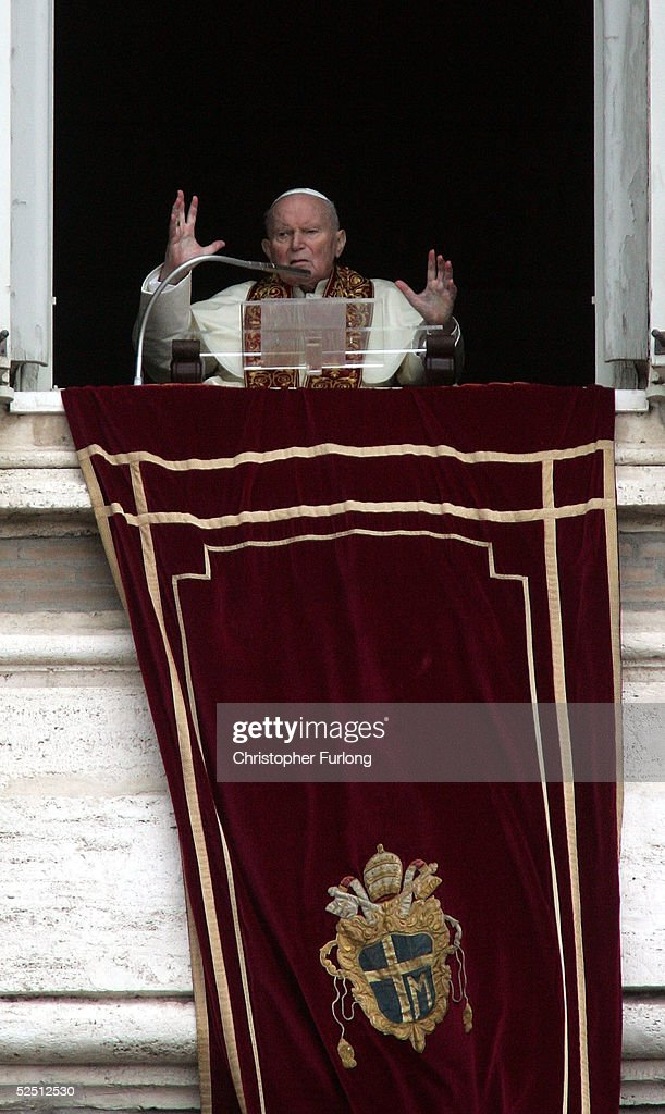 Pope John Paul II appears at the window of his private apartments on March 27, 2005 Vatican City. Anguished and unable to speak he blessed the thousands of Pilgrims in St Peter's Square at the end of Easter Mass.