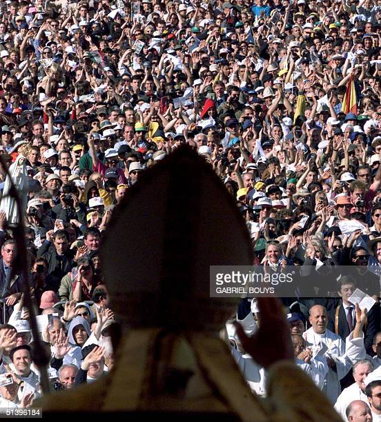 Pope John Paul II blesses the pilgrims in Fatima 13 May 2000 during the mass of beatification of the two dead shepherd children Jacinta and Francisco...