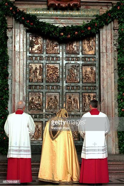 Pope John Paul II closes the Holy Door of St Peter's Basilica during a ceremony that marks the end of the Roman Catholic Church's special 2000...