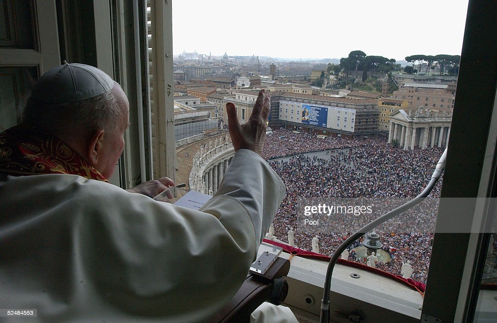 Pope John Paul II gives his blessing to pilgrims and faithful gathered in St. Peter's Square at the end of the Easter Sunday Mass, March 27, 2005 in Vatican City. Photo by: Arturo Mari Vatican Pool/ Getty Images