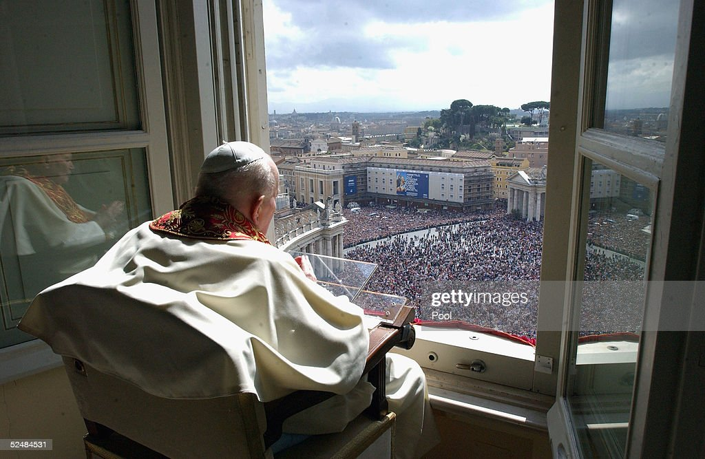 Pope John Paul II gives his blessing to pilgrims and the faithful gathered in St. Peter's Square at the end of the Easter Sunday Mass, March 27, 2005 in Vatican City.