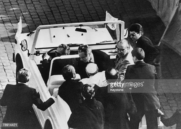 Pope John Paul II is driven away from St Peter's Square having been shot by wouldbe assassin Mehmet Ali Agca 13th May 1981