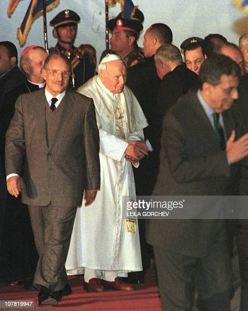 Pope John Paul II is seen off by Egyptian President Hosni Mubarak and other government and religious delegates at Cairo airport 26 February 2000 The...