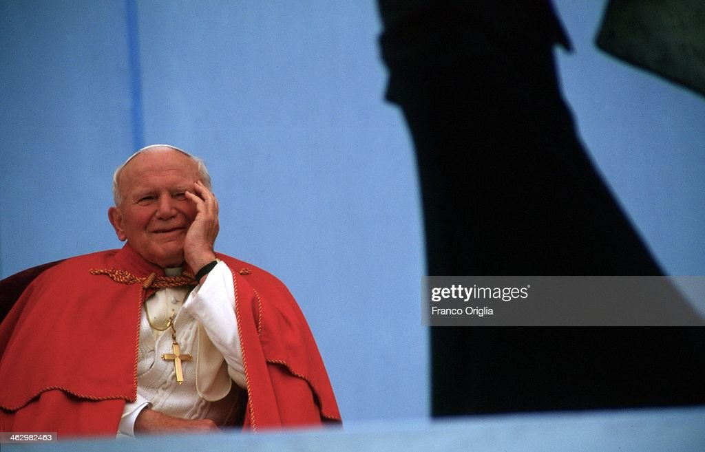 Pope John Paul II laughs as he attends a meeting with the youth during his official visit to Czech Republic on May 21, 1995 in Olomouc, Czech Republic.