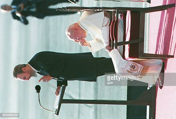 Pope John Paul II listens to Cuban President Fidel Castro 21 January as he delivers his welcoming speech at Jose Marti International Airport in...