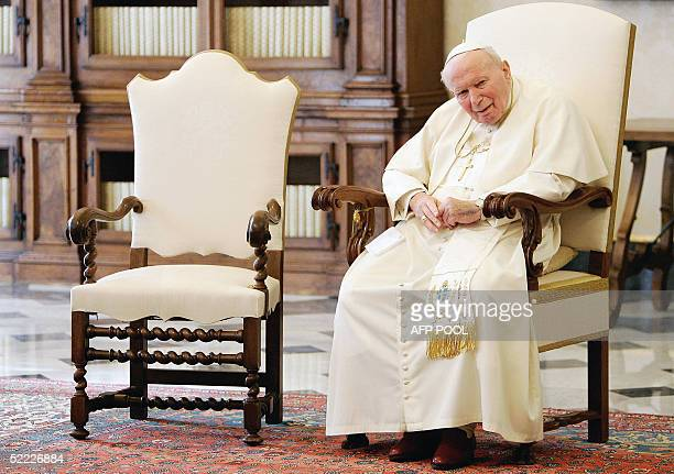 Pope John Paul II looks on as he waits in his library before a private meeting with the Croatian Prime Minister Ivo Sanader at the Vatican 22...
