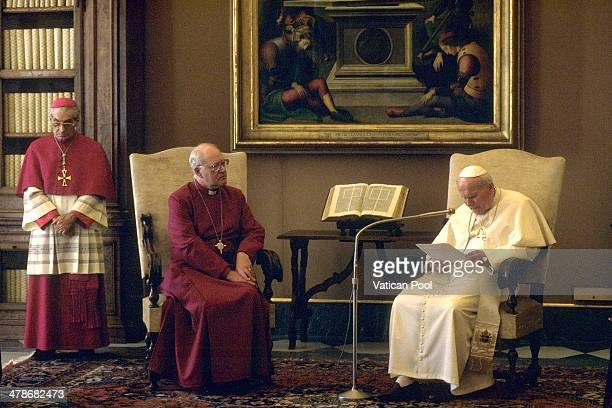 Pope John Paul II meets Archbishop of Canterbury George Carey at his private library in the Apostolic Palace on December 5 1996 in Vatican City...