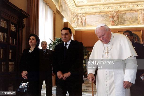 Pope John Paul II meets Egyptian President Hosni Mubarak and his wife at his private library in the Apostolic Palace on February 20 2001 in Vatican...