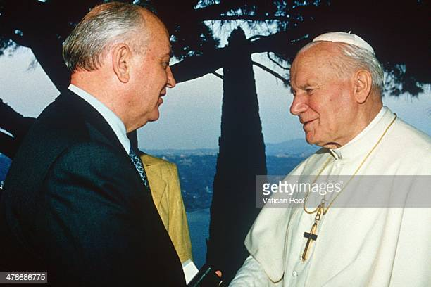 Pope John Paul II meets Soviet leader Mikhail Gorbachev on the terrace of his summer residence overlooking the lake of Albano on Castel Gandolfo...