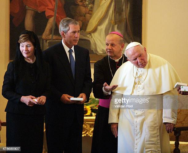 Pope John Paul II meets US President George W Bush and his wife Laura Bush at his summer residence on July 23 2001 in Castel Gandolfo Italy