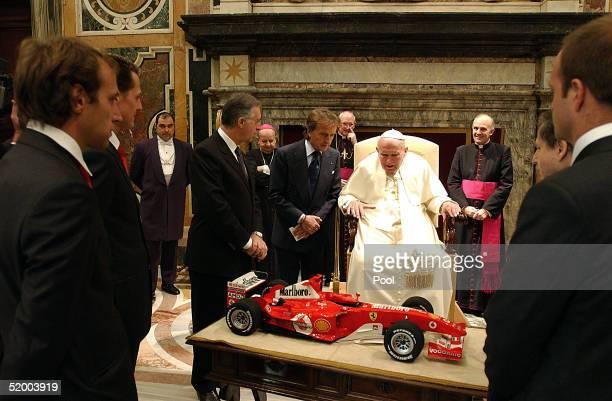 Pope John Paul II receives as a gift from Ferrari President Luca Cordero di Montezemolo Michael Schumacher Brazilian teammate Rubens Barrichello...