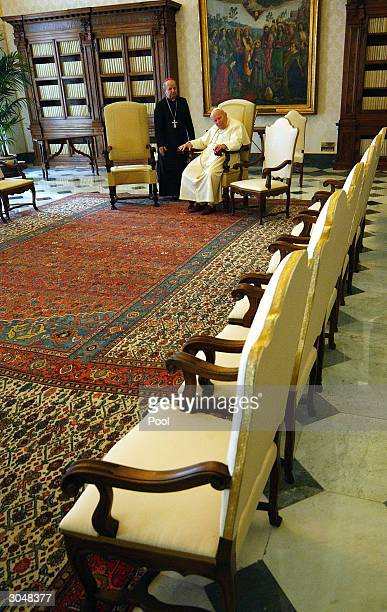 Pope John Paul II sits in his private library after a meeting with German President Johannes Rau March 6 2004 in Vatican City The Pope encouraged...