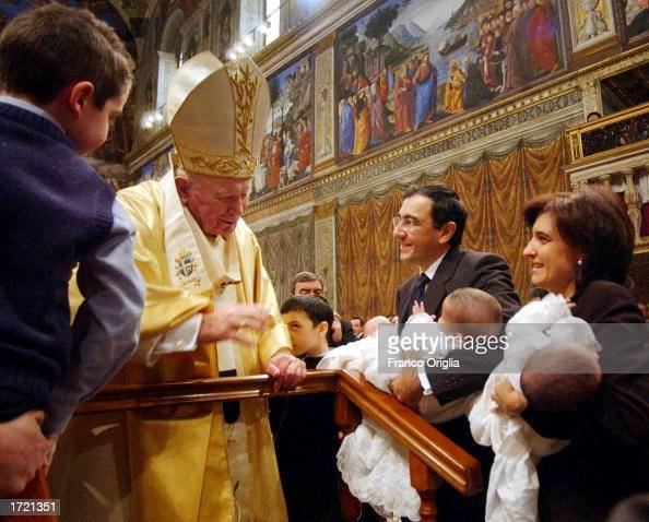 Pope John Paul II smiles as Ilde and Vincenzo Morgante hold two of their triplets at the end of a special Baptism ceremony during Sunday Feast of the...