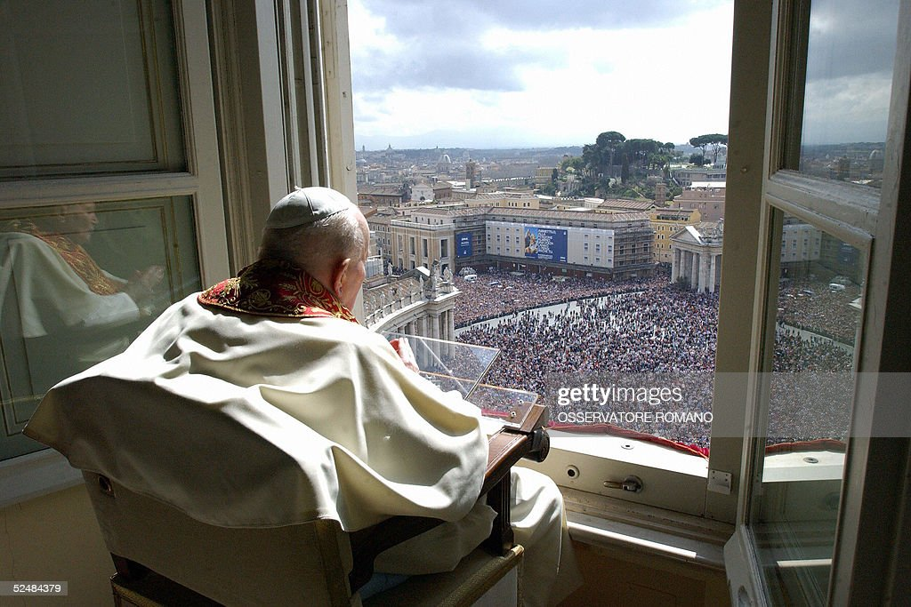 Pope John Paul II tries to deliver his Urbi et Orbi blessing to the pilgrims gathered in St-Peter's square at the Vatican, during the Easter mass, 27 March 2005. Though he struggled with all his might, a frail Pope John Paul II failed to voice a traditional Easter Sunday blessing for the first time in his 26-year pontificate, in an appearance at his apartment window overlooking a rain-dampened St Peter's Square. AFP PHOTO/ POOL / OSSERVATORE ROMANO / Arturo MARI